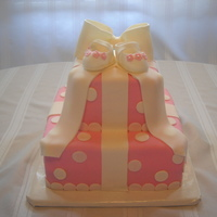 Baby Shower Cake   10 inch and 8 inch vanilla cake covered with MMF, shoes made with gumpaste/fondant, pattern found on CC