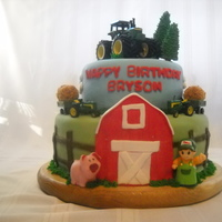 John Deere Birthday Cake  12 INCH VANILLA CAKE AND 8 INCH CHOCOLATE CAKE COVERED IN FONDANTHAY BALES ARE MARSHAMALLOWS COVERED IN PEANUT BUTTER & CRISPIX CEREAL...