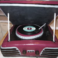'ray' 50's style record player that was made for a couple celebrating their joint 55th birthday. Record is real with label made to represent...