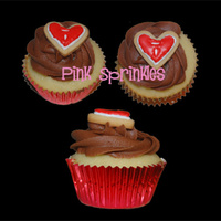 Thank You For Your Help!  Vanilla Cupcake filled with Chocolate Buttercream swirled with BC and topped with a vanilla heart shape sugar cookie piped with the...