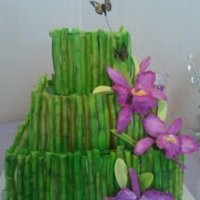 Bamboozeled Hawaiian theme wedding cake. My first gum paste orchid.