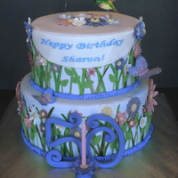 Hummingbird Garden Surprise cake for my Mom's good friend. Hummingbird and butterflies made from gumpaste. Thankyou Kitagrl for the wonderful inspiration...