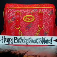 Coogi Purse Made to look like a friend's daughter's Coogi Purse. White cake filled and iced with cheesecake buttercream, covered in MMF. This...