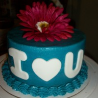 With Love buttercream with fondant letters and silk flower