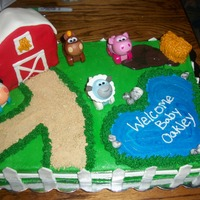 Barnyard Baby Shower buttercream with fondant accents. animals are toys and barn is RKT