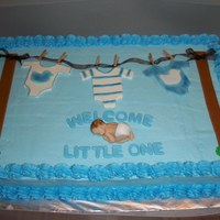 Clothesline Baby Shower buttercream sheet cake with fondant accents.