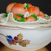 Peaches In An Evesham Bowl Bowl is an all butter pound cake covered in fondant and hand painted. I made the peaches out of fondant as well.