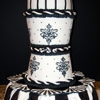 Formal Black And White Domed black and white cake with a slightly tapered middle, fondant roping and draping, stenciled damask pattern, run in sugar striped fan...