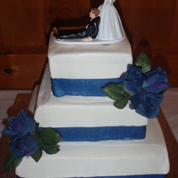 "Square Buttercream Wedding Cake This was my first wedding cake :). 12"", 8"", 6"" tiers with buttercream and blue ribbon. Silk flowers. Bride picked the topper..."