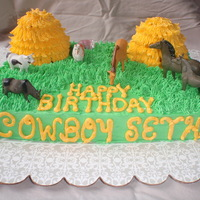 Farm Cake Farm theme cake for a little boy's 3rd birthday. Haystacks are cake (mini wondermold). Figures are plastic.