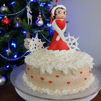 Santa Betty Boop This cake was for my friend 40th UNbirthday. She loves Betty Boop and Her bday is close to christmas so its a christmas unbirthday cake....