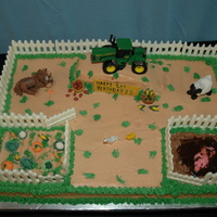 Farm Cake the tractor is a toy, but all the animals, and vegs are mmf, the fence is white chocolate