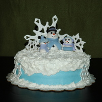 Snow Family This was for my sons teacher for christmas. Devil foods cake with BC