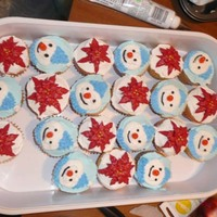 Poinsettas And Snowmen I made these cupcakes for my mom to take to work. Everything is buttercream, including the poinsetta's.