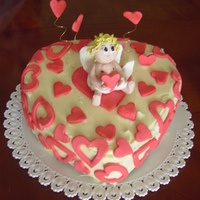 Cupido a chocolate mudcake filled and covered with white ganache