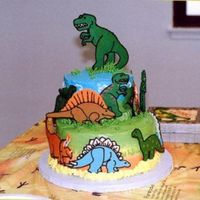 "Prehistoric Birthday Cake Everyone loved this cake for my 9 year olds birthday party. It's a 2 tier cake (6"" & 9"") - bright buttercream frosting..."