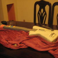 A Guitar Hero For My 15 Years   this guitar was made yourself with a chocolate cake and vanilla GenoiseSatin fondant