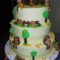 Moneky Cake 3 tier monkey cake for a first birthday at church. Iced with butter cream and fondant decorations