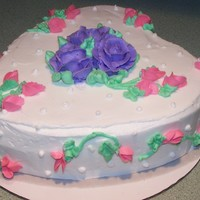 White Cake With Violet Roses And Pink Sweet Peas