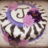 Purple Zebra   This cake was done for a friend of mine for her birthday. Iced in buttercream and decorated with silk flowers.