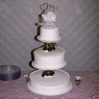 100_5560.jpg My 1st wedding cake.Buttervream icing with burgandy roses. I used the impression mat also.
