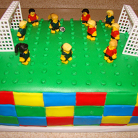 Lego Soccer Cake   Made for my niece who loves soccer and legos. She asked for a lego cake and I wanted to do something beside just stacked legos.