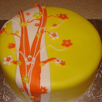 Yellow And Orange Birthday Cake   Made for my daughter's birthday. Coconut cake with coconut pudding filling. MMF
