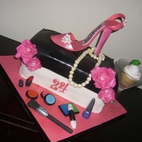 """i'm A A Diva"" Entire cake is edible. Shoe made of MMF, fantasy flowers and make up."