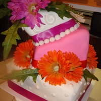 Topsy Turvey Gerber Daisies This is my first topsy turvey cake, first wedding cake and second tiered cake.