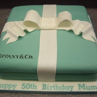 Tiffany Box Cake My first novelty cake ever! Nice simple square cake covered in sugarpaste and finished with a flowerpaste bow :)