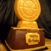 Have Your Trophy And Eat It Too Dartboard trophy cake that I made for coworker's friends birthday. The gold topper is all Rkt. The cake looked so good with just...