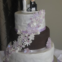 "First Wedding Cake This is my first wedding cake. 10"", 8"" and 6"" round. The 10"" is dark chocolate mudcake, nutella buttercream filling,..."