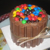 Mini Candy Cake   Chocolate cake with chocolate buttercream filling, with Kit Kats and M&M's.
