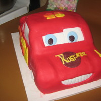 Lightning Mcqueen Birthday Cake My first attempt at carving a cake into a car! Chocolate cake, chocolate ganache and fond.ant