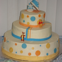 Winnie The Pooh Themed Baby Shower Cake buttercream with fondant accents. gumpaste bootie topper. (I still haven't mastered the whole smooth buttercream thing :) but i'm...