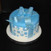Gift Box Cake   round gift box cake, covered in fondant with gumpaste bow.