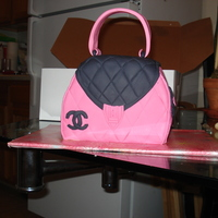Channel Bag Cake   My first handbag cake! It's a little lopsided and my fondant may have been rolled too thick but... what the heck it was delicious!