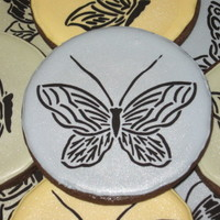 "Butterfly Cookies Here's my first stencil project. I love stenciling! The 3 & 5/8"" round cookies are Pumpkinwaffles Dark Chocolate Rolled Sugar..."