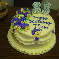 Birthday Cake With Pansies This cake was covered in buttercream with royal pansies. The pansies were hand-painted with accents using coloring gel thinned with water....