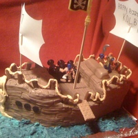 Kolby's Pirate Ship Chocolate cake with chocolate buttercream icing covered in fondant with fondant decorations. used tootsie rolls for the railing and graham...