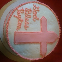 "Payton's Christening Cake   12"" white cake with buttercream icing and fondant cross"