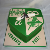 "Cleveland State Grad Cake  This is the emblem for Cleveland State University. I carved a 9 in square cake. The ""a"" and ""8"" was made using the..."