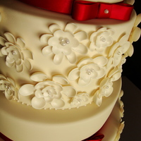 Ivory/burgundy Daisy Cake This was my first wedding cake :)!!!!! Yay! The orginal design was done by Zoe Clark Cakes. The bride insisted on not changing a thing, so...