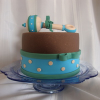 Welcome Baby Boy!!  This is a 6in vanilla WASC with buttercream and raspberry filling. Ganache under chocolate MMF. The rattle is made with fondant/tylose. I...