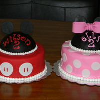 Mickey And Minnie Mouse Cakes For Twins   I did these cakes for two year old twins. Mickey is chocolate and Minnie is vanilla. The hats are RKT covered in fondant.