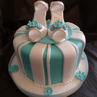 Tiffany Shoes Cake  Bright blue turquoise cake with white stripes like a Tiffany box! The shoes are made of gumpaste and pearl dusted and then dressed the...