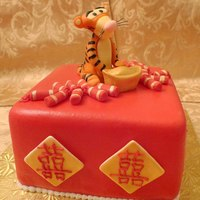 Year Of The Tiger!  A chinese new year cake made with red fondant and gold chinese double happiness symbols. 2010 is the year of the Tiger and so the cake is...