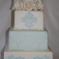 Damask Stencil On Blue And White Square damask stencil with gum paste rose topper
