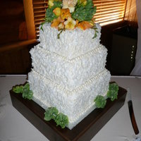 Simple Coconut Covered Cake A simple 3 tier square covered in coconut flakes and topped with fresh flowers. Simple and elegant.