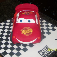 Lightning Mcqueen Choc cake. Used Wilton car pan and carved away the unwanted bits.